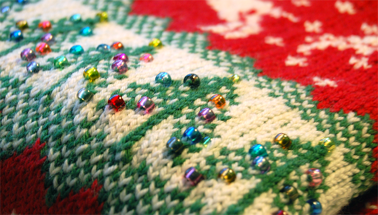 beads on christmas sweater