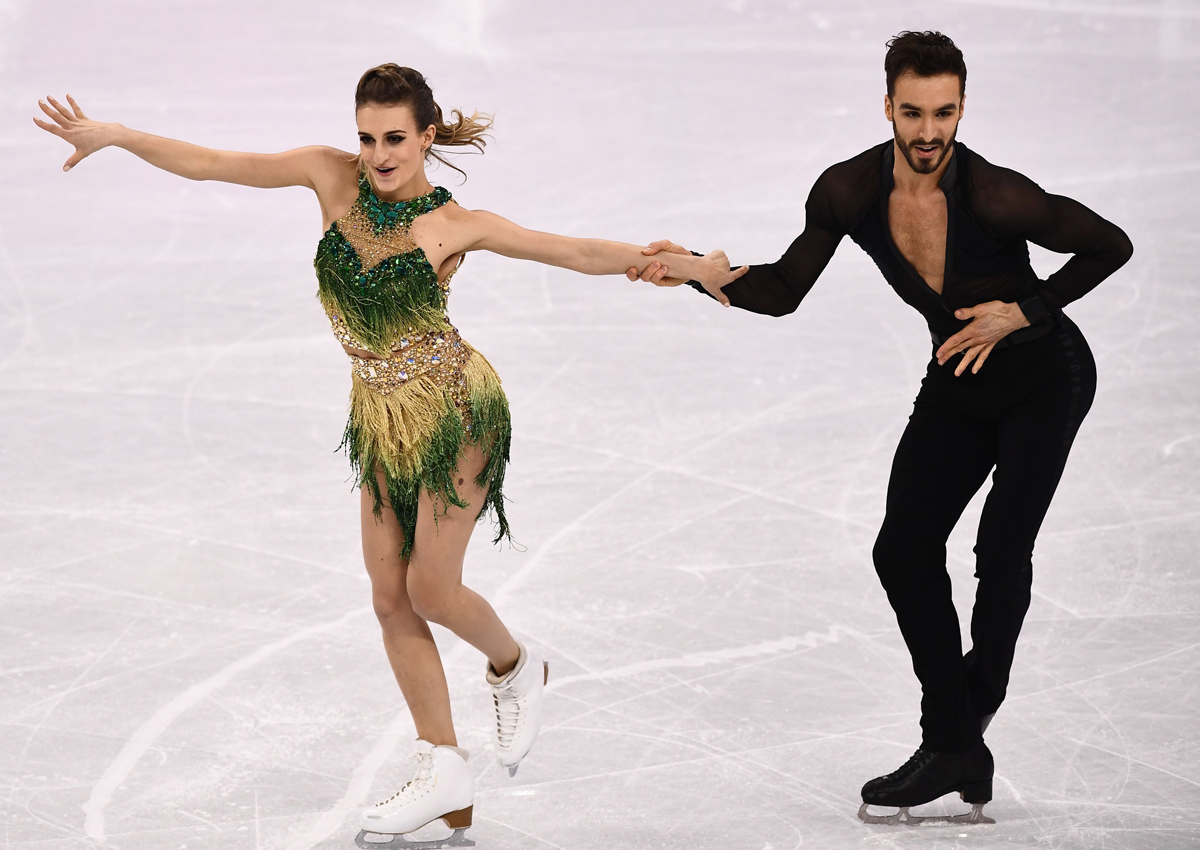 Despite the sartorial setback the French pair were in second place behind Canada's Tessa Virtue and Scott Moir, who smashed the short dance world record.