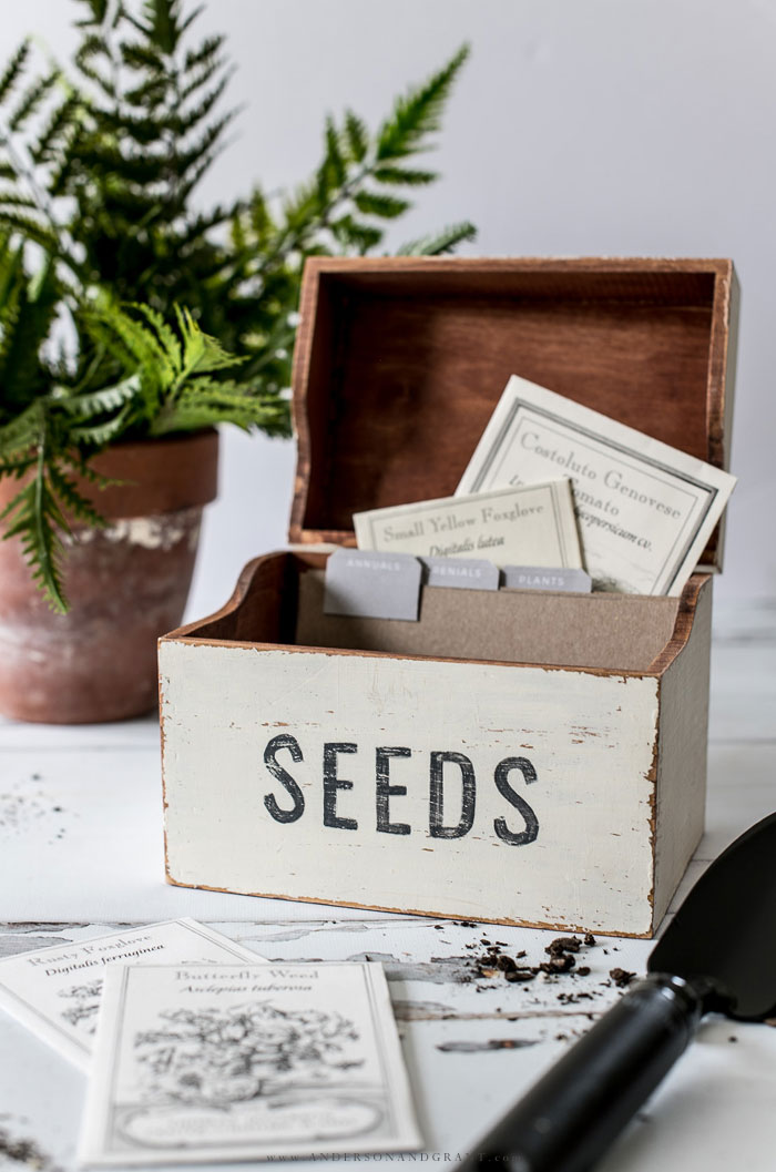 Garden seeds stored in wood box.