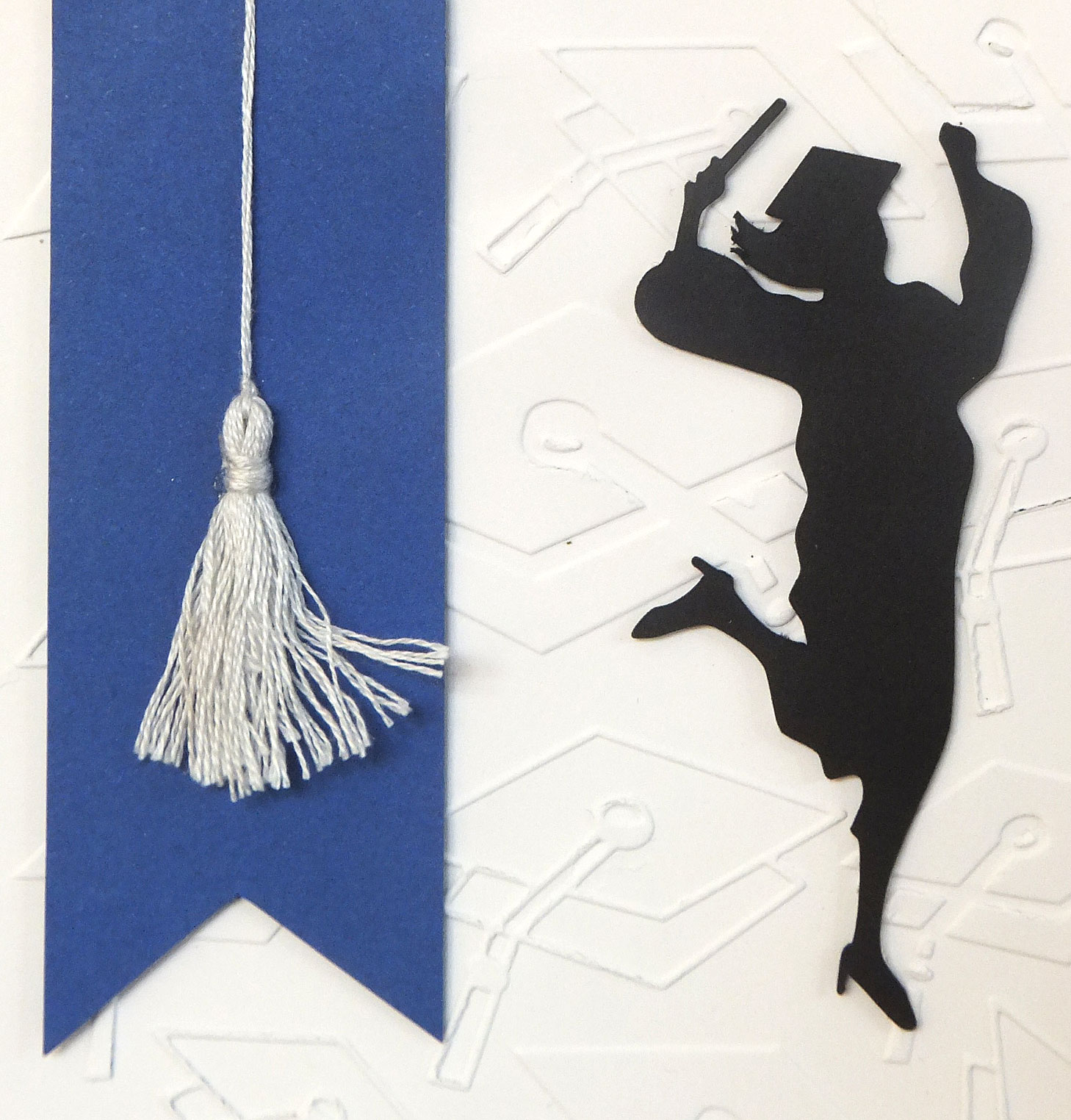 i created my tassel out of some silver embroidery thread and i cut my jubilant graduate using a silhouette cutting file this cut file came with both a