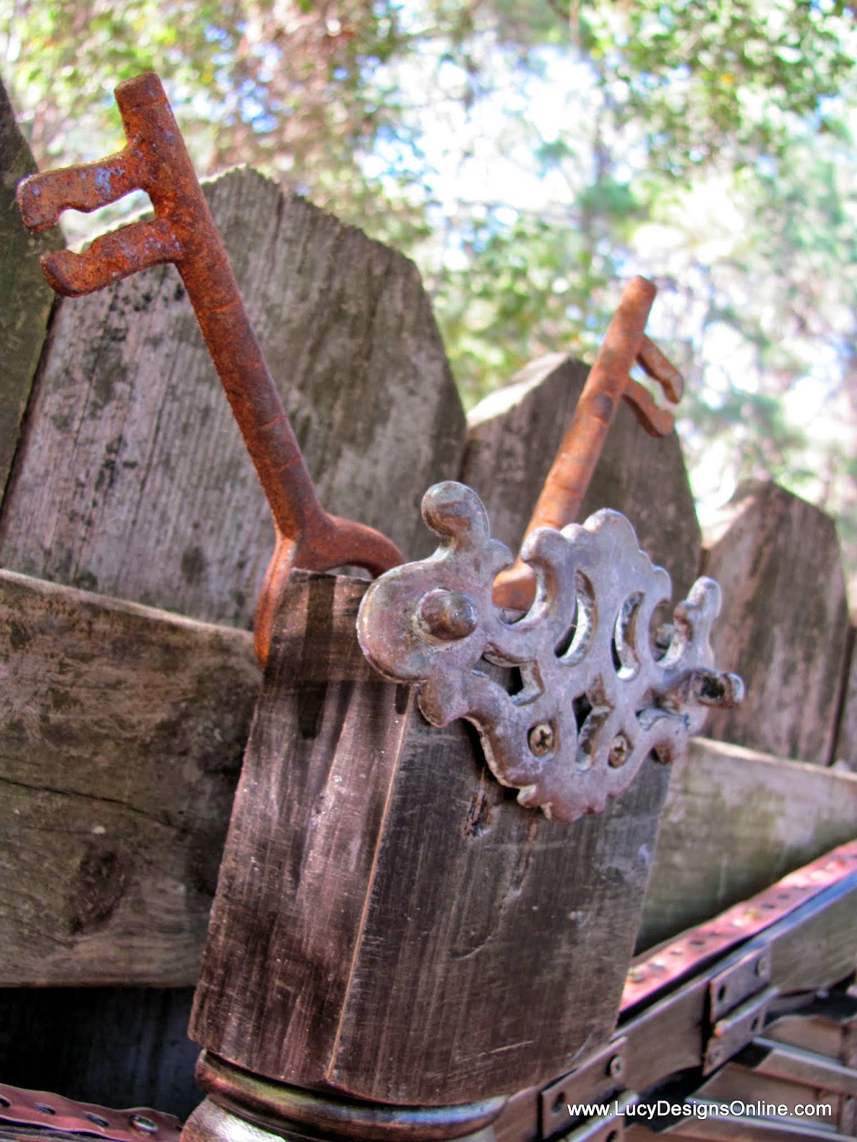 old keys, hinges and drawer pulls on giant sculpture