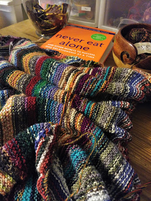 knitting a garter stitch blanket while reading Never Eat Alone by Keith Ferrazzi