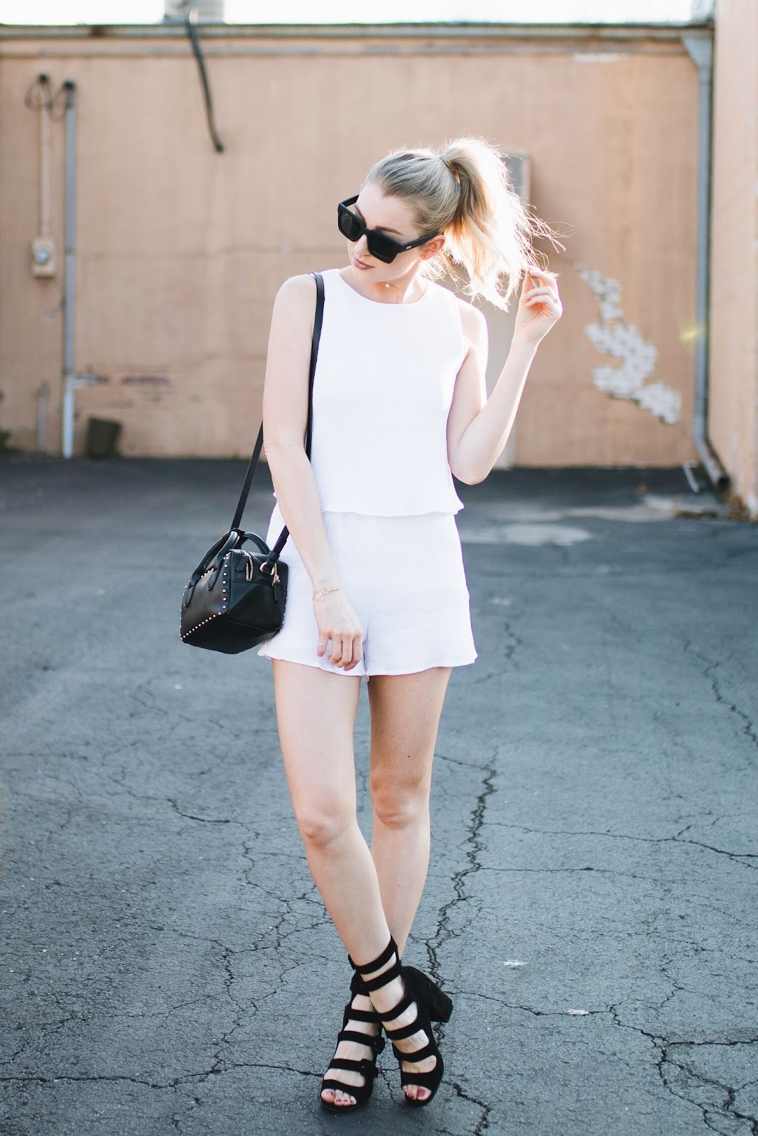 white romper with black accessories