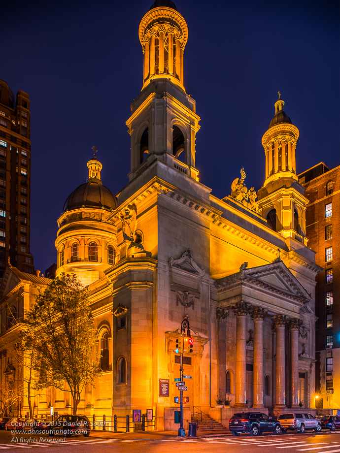a photo of a catholic church in new york taken at night