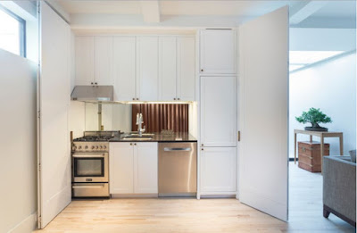how to hide contemporary kitchen behind folding doors