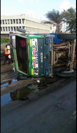 Truck spills contents after falling in Apapa, Lagos