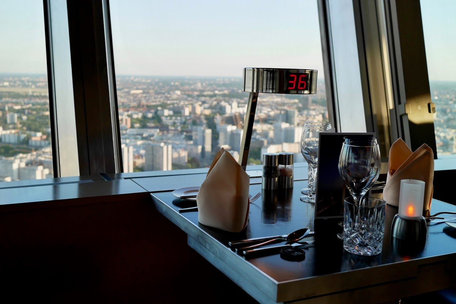 having dinner in the 360 deg revolving restaurant in berlin, looking over the city at nightfall by www.CalMcTravels.com. Cal McTravels