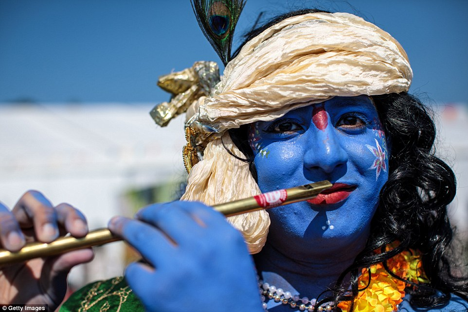 A man dressed as the Hindu god Lord Krishna, poses during the Janmashtami Festival at Bhaktivedanta Manor as thousands joined together for one of the most important events in the Hindu calendar