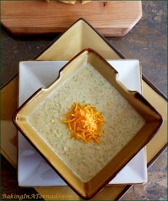 Creamy Vegetable Rice Soup is a cold weather staple. This hearty soup is made with fresh vegetables and brown rice, perfect for a warming winter lunch or dinner. | Recipe developed by www.BakingInATornado.com | #recipe #soup