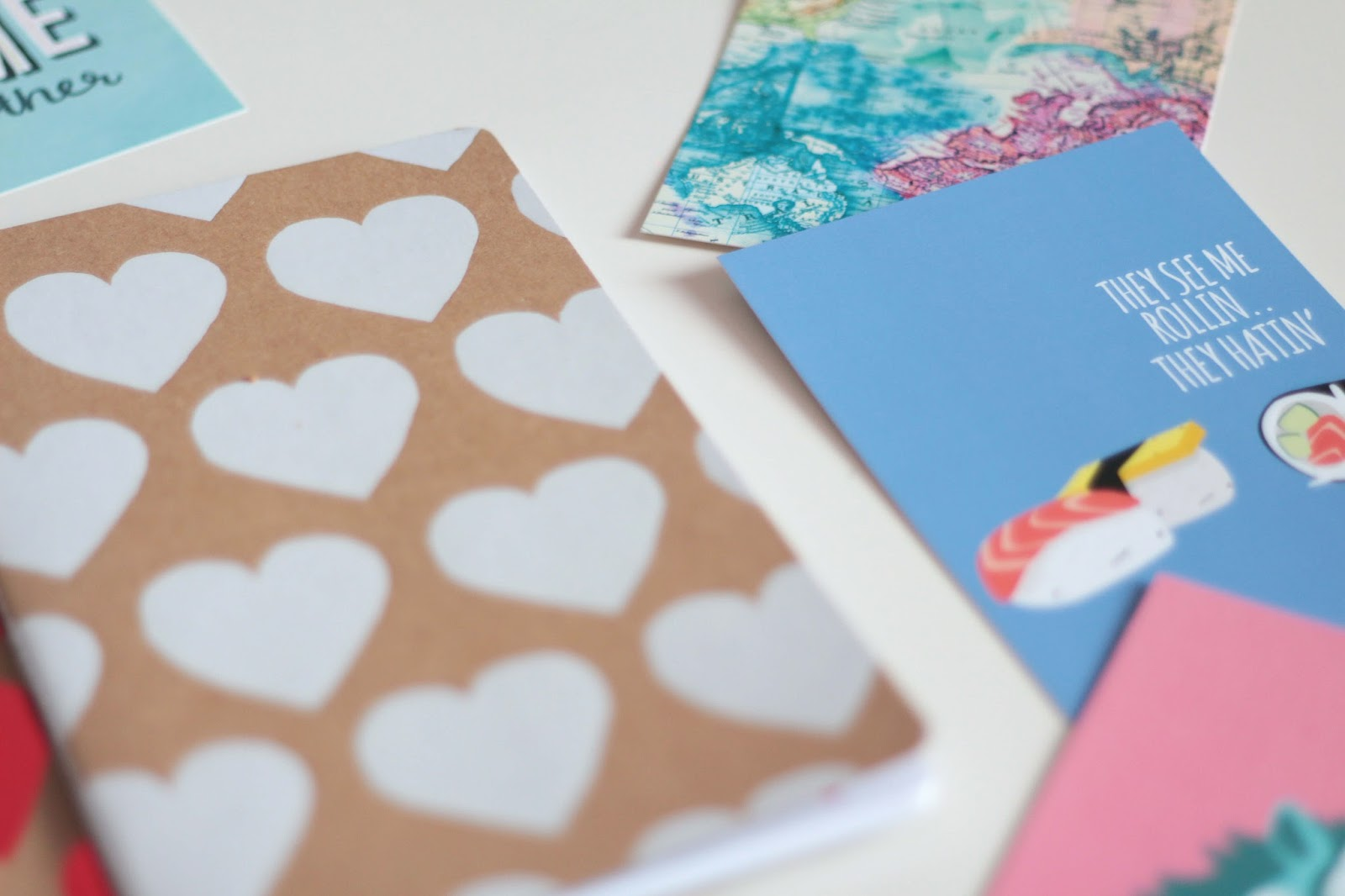 desk lay paperchase notebooks and postcards