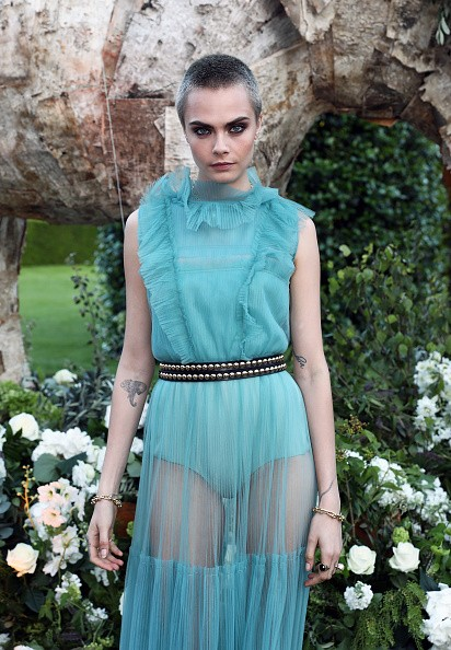 Cara Delevingne flaunts her tattoo at Save the Elephants event