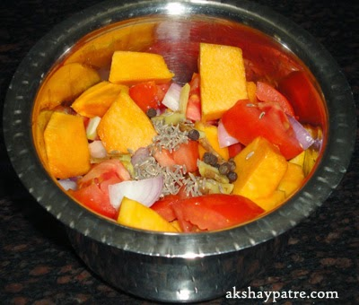 Chopped vegetables in a vessel - preparing pumpkin soup