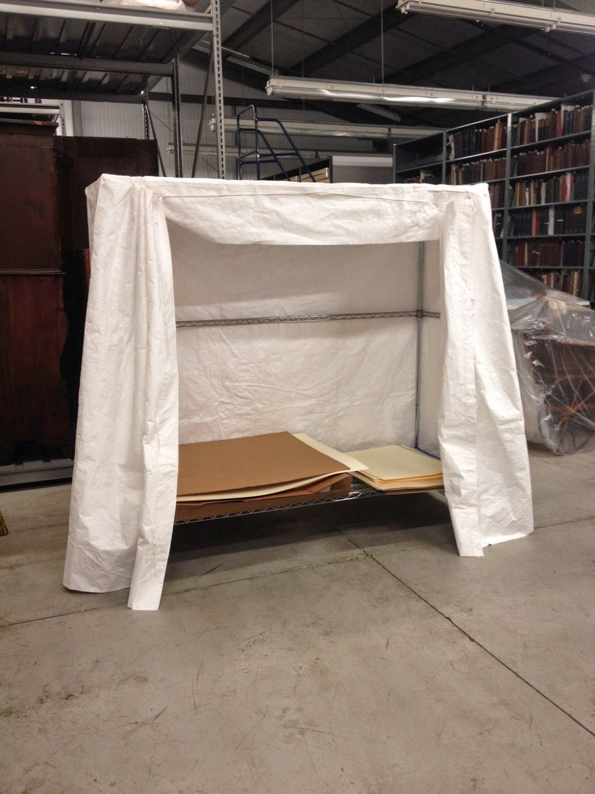 Custom made tyvek dust cover for the archival storage of historic clothing. Designed and created by Gwen Spicer of Spicer Art Conservation