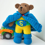 http://www.redheart.com/free-patterns/super-hero-bear-set
