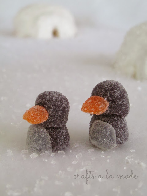 white snow and ice scene with gumdrop penguins