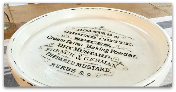 White pedestal plate with writing