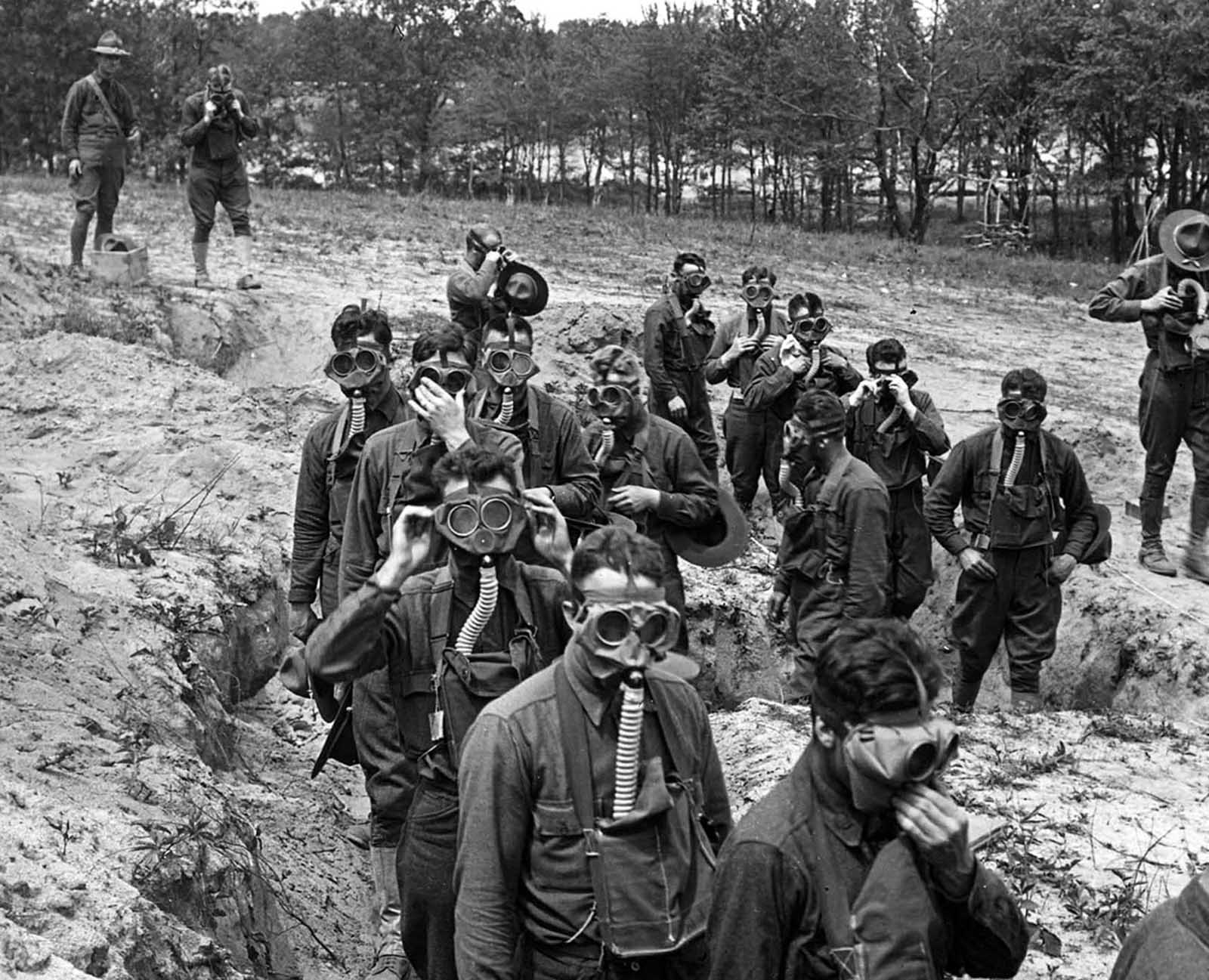 U.S. Soldiers in training, about to enter a tear gas trench at Camp Dix, New Jersey, ca. 1918.
