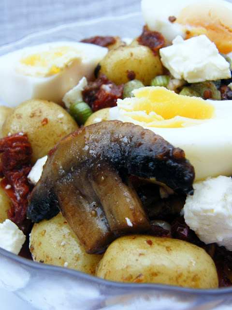 Close up of Hearty Potato, Egg & Feta Salad in a glass bowl