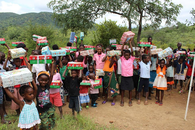 Dozens of children from Zambia excited to open their Operation Christmas Child shoeboxes.