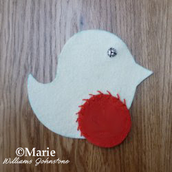 Using hand embroidery to sew the felt pieces together