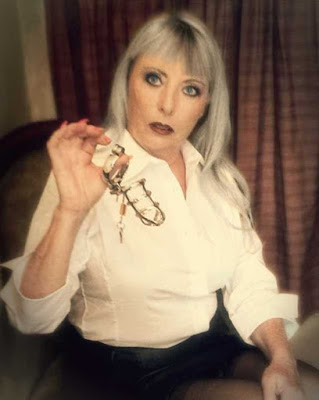femdom bdsm dominatrix mistress showing spiked chastity device