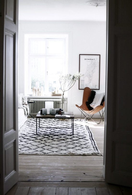 Scandinavian interiors with the typical black and white contrast spiced up by the camel leather of the butterfly chair.