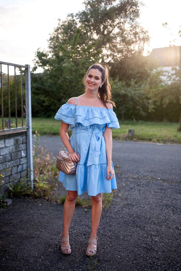 Outfit: blue ruffle off shoulder dress, rose gold cross body bag