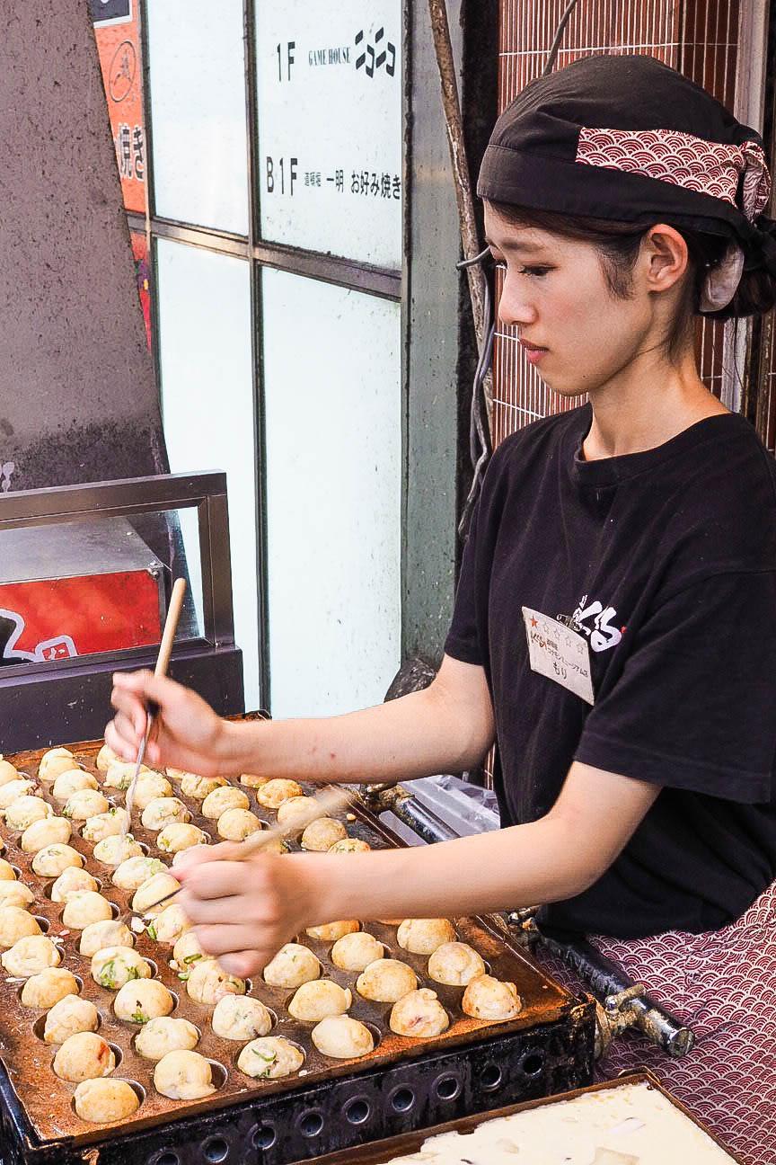 Making takoyaki on Dotonbori Street, Osaka