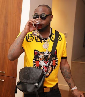 See The Long Queue Of People Begging For Money In Front Of Davido's House (Photos)
