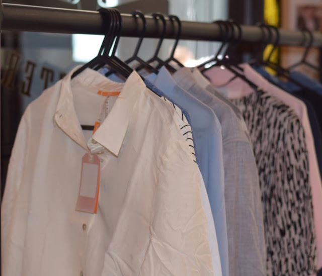 designer clothes on hangers at The Hut Summer Event