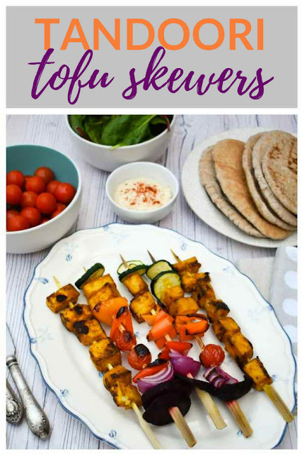 Grilled Tandoori Tofu Skewers. skewers stacked with tandoori marinated tofu and a selection of colourful vegetables. Includes recipe for tandoori marinade. Only 94 calories per skewer. #skewers #tofu #tofuskewers #tofurecipes #veganBBQ #tofurecipes