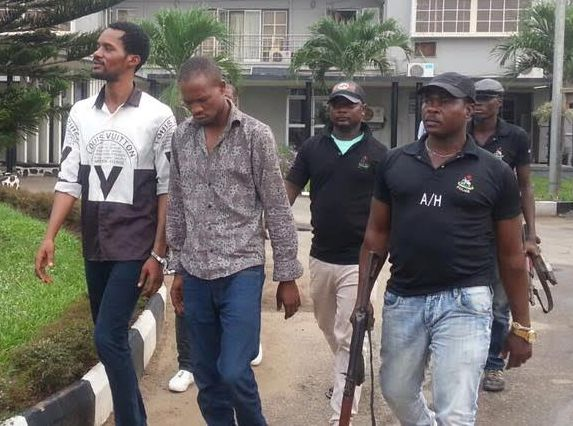 Photos of Seun Egbegbe in handcuffs in court today