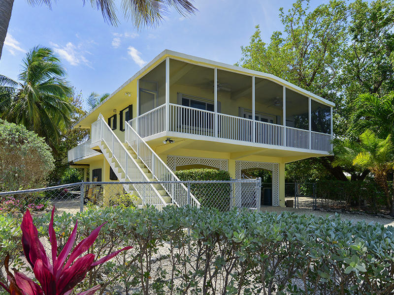 Upper florida keys homes for sale yvette doherty your for Canal front house plans