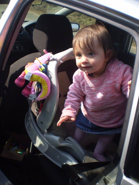 eldest pictured standing up in car seat facing open door