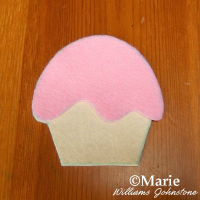 Pink and cream sections of cut felt pieces