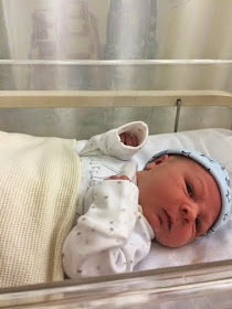 newborn baby Jacob in hospital cot