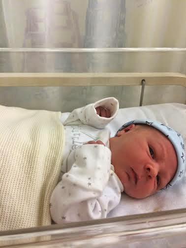 newborn baby Jacob in hospital cot