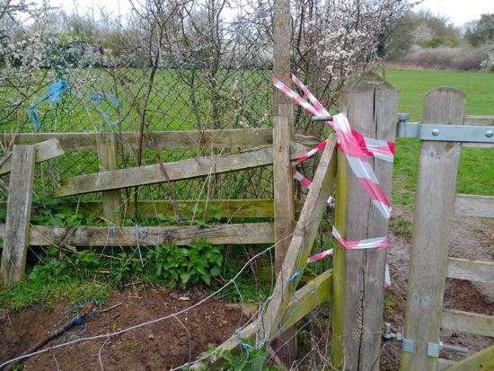 Image: Broken fence at junction of footpath 86 and entrance to NMPC land Image by North Mymms News Released under Creative Commons BY-NC-SA 4.0