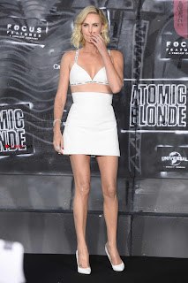 Charlize Theron exposing her mive   to Crowd Enjoying dirty touches at  Premiere of Atomic Blonde in Berlin