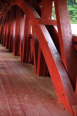 Complex Wooden beam structure with arch painted red