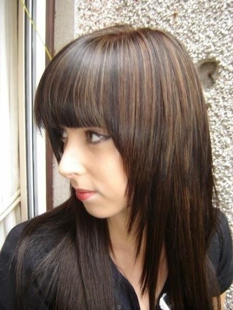 Dark brunette with sun-kissed highlights