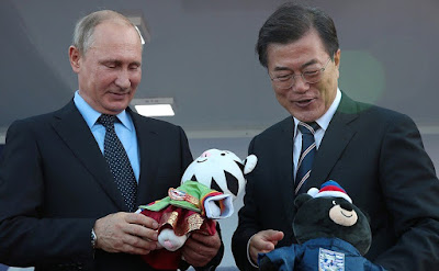 Vladimir Putin and President of South Korea Moon Jae-in.