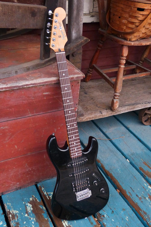 korean-made-fender-guitar-black-mansion