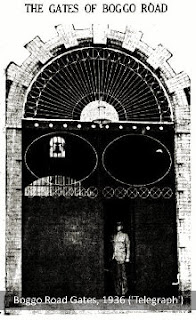 An officer stands at the gates of Boggo Road Gaol, 1936 ('Telegraph')