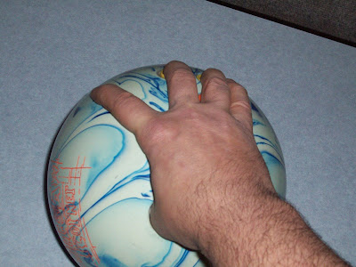 bowling finger positions, bowling tip, bowling hand position, bowling techinque