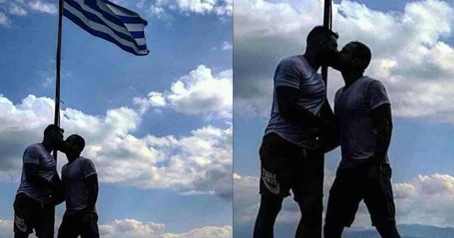 Αξιωματικός της ελληνικής αστυνομίας φιλιέται με μετανάστη μπροστά στην Ελληνική σημαία