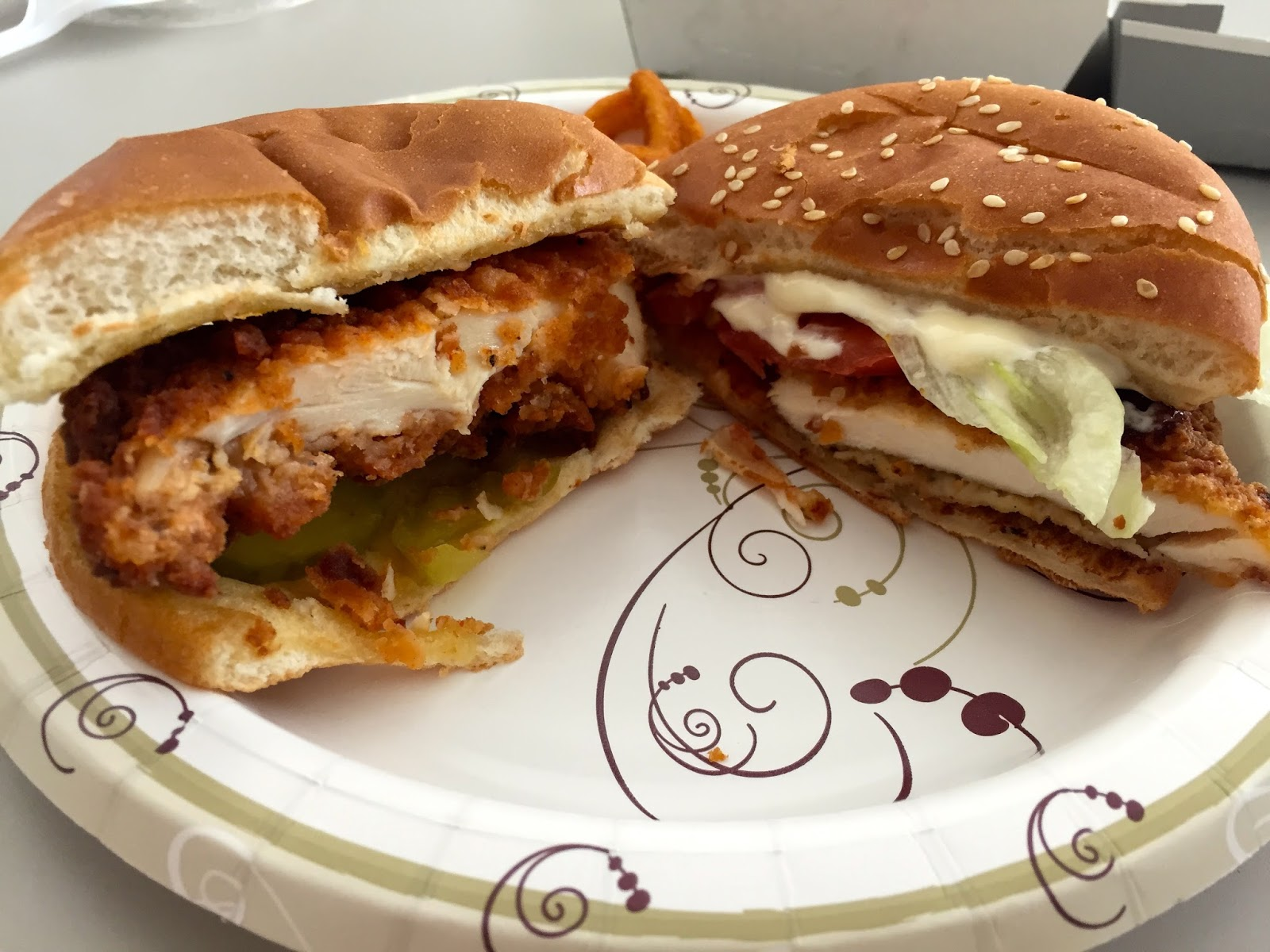 On The Left You See Chick Fil A Spicy Chicken Sandwich With Some Mayo And Pickles Sauce Side Because Its Just Not Fair To Compare