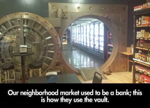 giant door and hinges of bank vault circular door