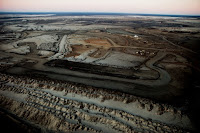 An oil sands mine near Fort McMurray, Alberta, Canada. (Credit: Chris Krug/flickr0) Click to Enlarge.