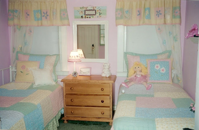 Garden style pink and green girls's bedroom with two beds